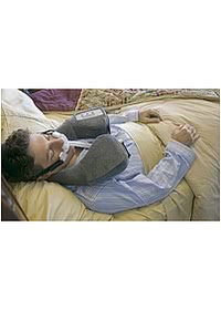 BreatheX CPAP Worn Man Bed