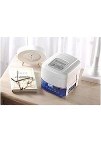 Devilbiss IntelliPAP with Humidifier on desk closup